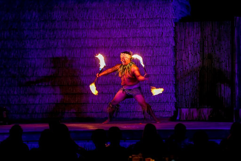 Island Breeze Luau man spinning fire